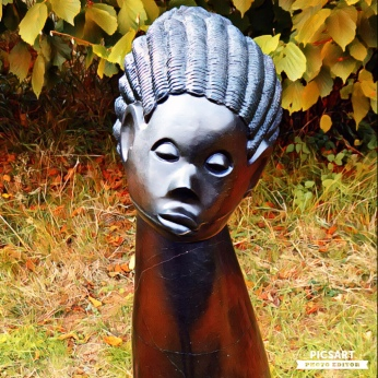 Black sculpture of head at Bothy Vineyard, Oxfordshire, sculpture in the vineyard