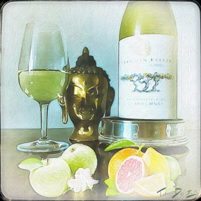 Green apples and citrus fruits poke through a glass of Leeuwin Estate Prelude Chardonnay