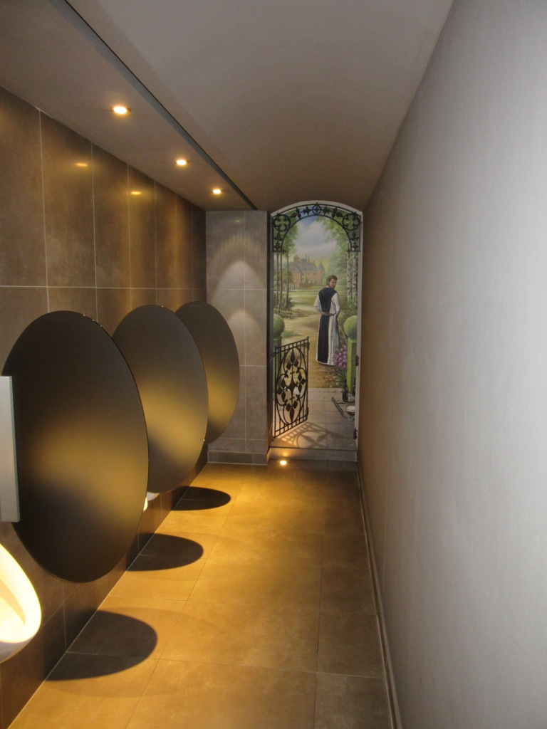 Brussels toilet with a mural of a monk urinating in garden