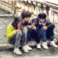 Three tourists with phones at the Capitoline Museum, Rome