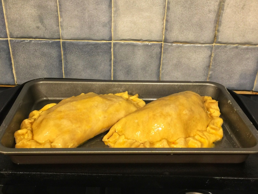 Pasties glazed for baking with an egg/milk mixture